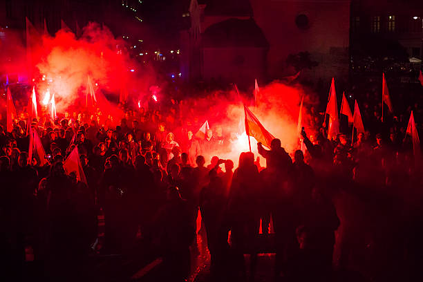 Krakow, Poland - November 11, 2015: Protesters march through center of city. About 3.000 people took part in March of Free Poland. Participants chanted slogans Neither EU nor NATO, Poland only for Poles.